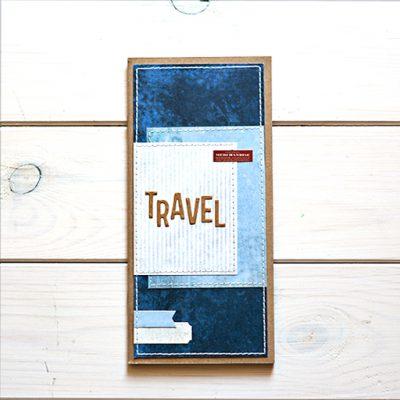 granatowy Travel Journal z napisem TRAVEL