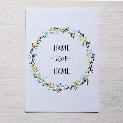 pocztówka z wieńcem kwiatowym i napisem home sweet home